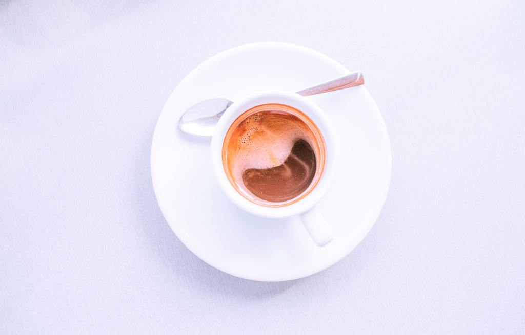 Image of a cup of coffee. Take regular breaks to increase productivity.