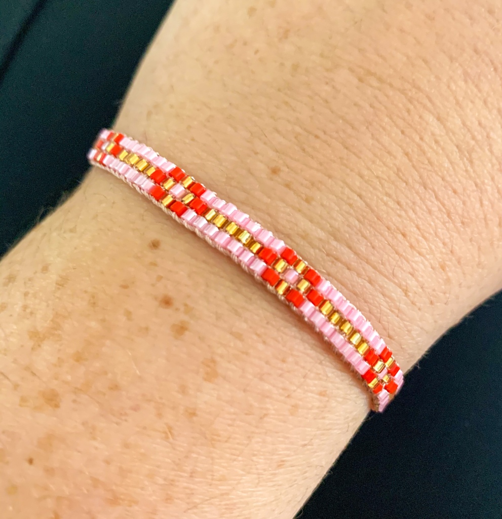 Pink and red friendship bracelt from Lily & Stella